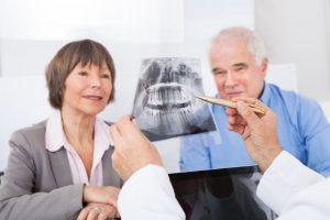 An older couple examining an X-ray.
