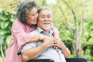 couple smiling after dental implants success